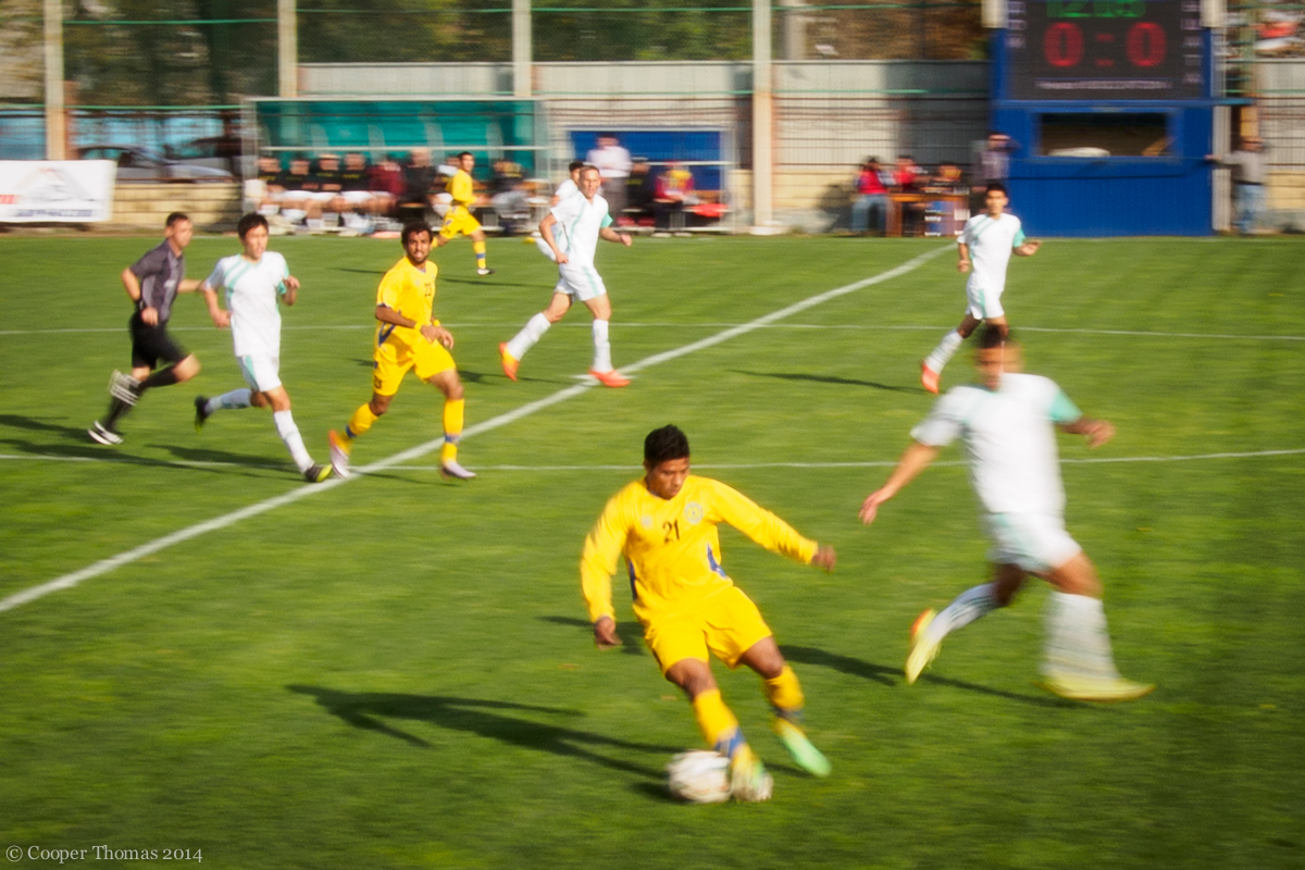 A recent Top League match between FC Dordoi  (yellow) and Abdysh-Ata. (Note to self: panning during sports matches doesn't really work.)