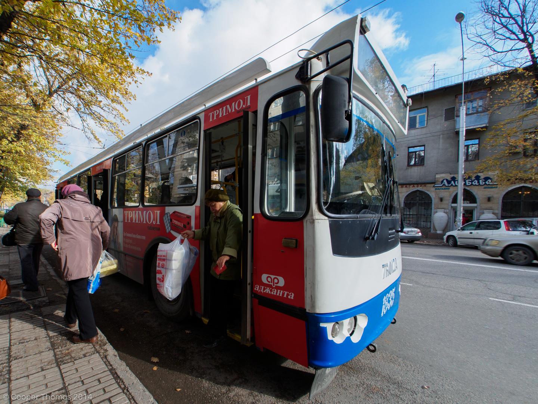Babushkas disembark from a tram