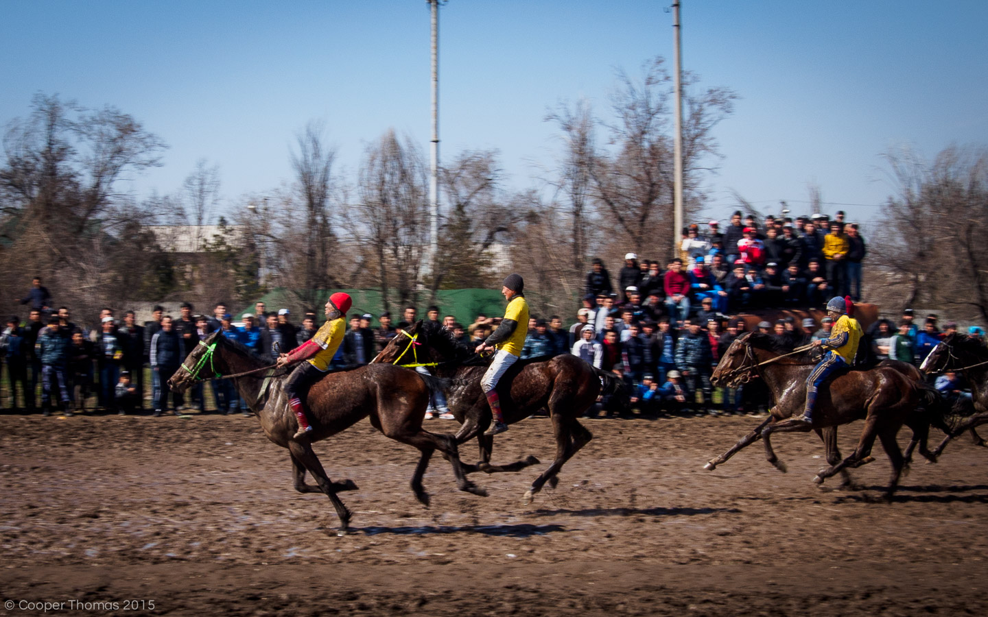 Young riders struggle to control their horses in the first race of the day