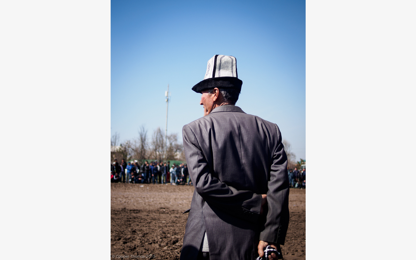Another kalpak'd fellow watches the races intently