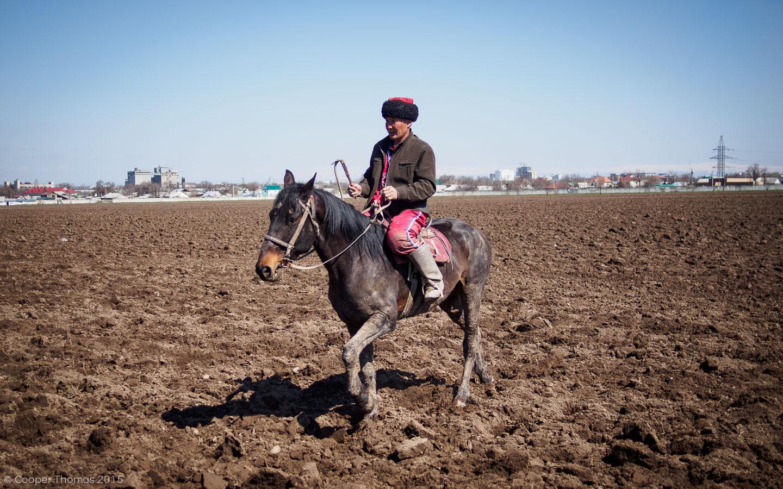 A random dude on horseback, just chillin'