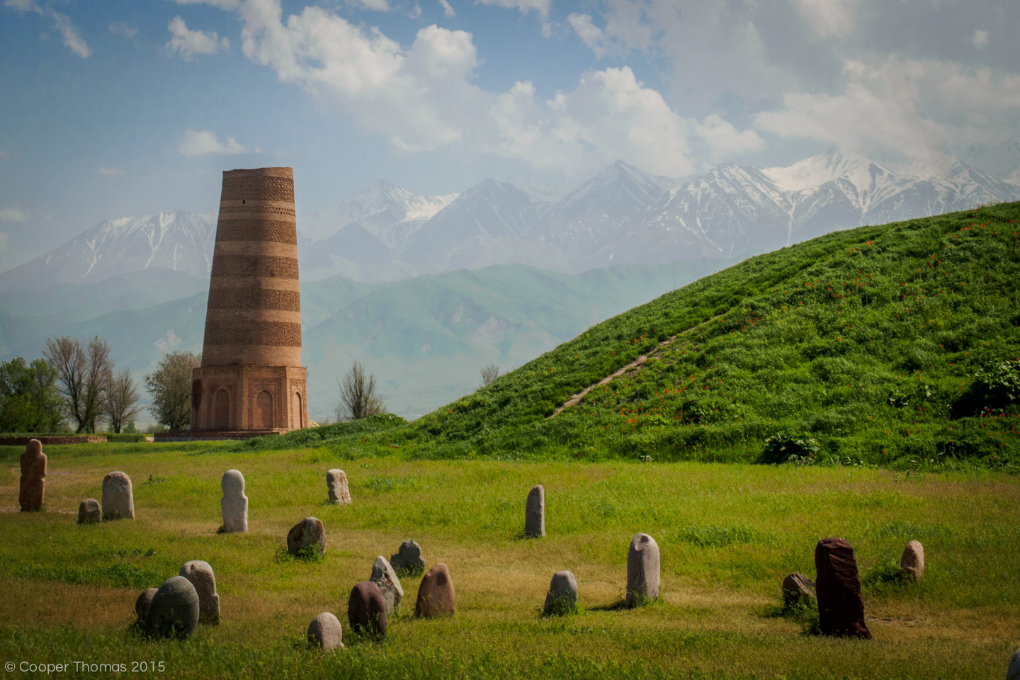 Burana Tower in spring, with burial stelae in the foreground