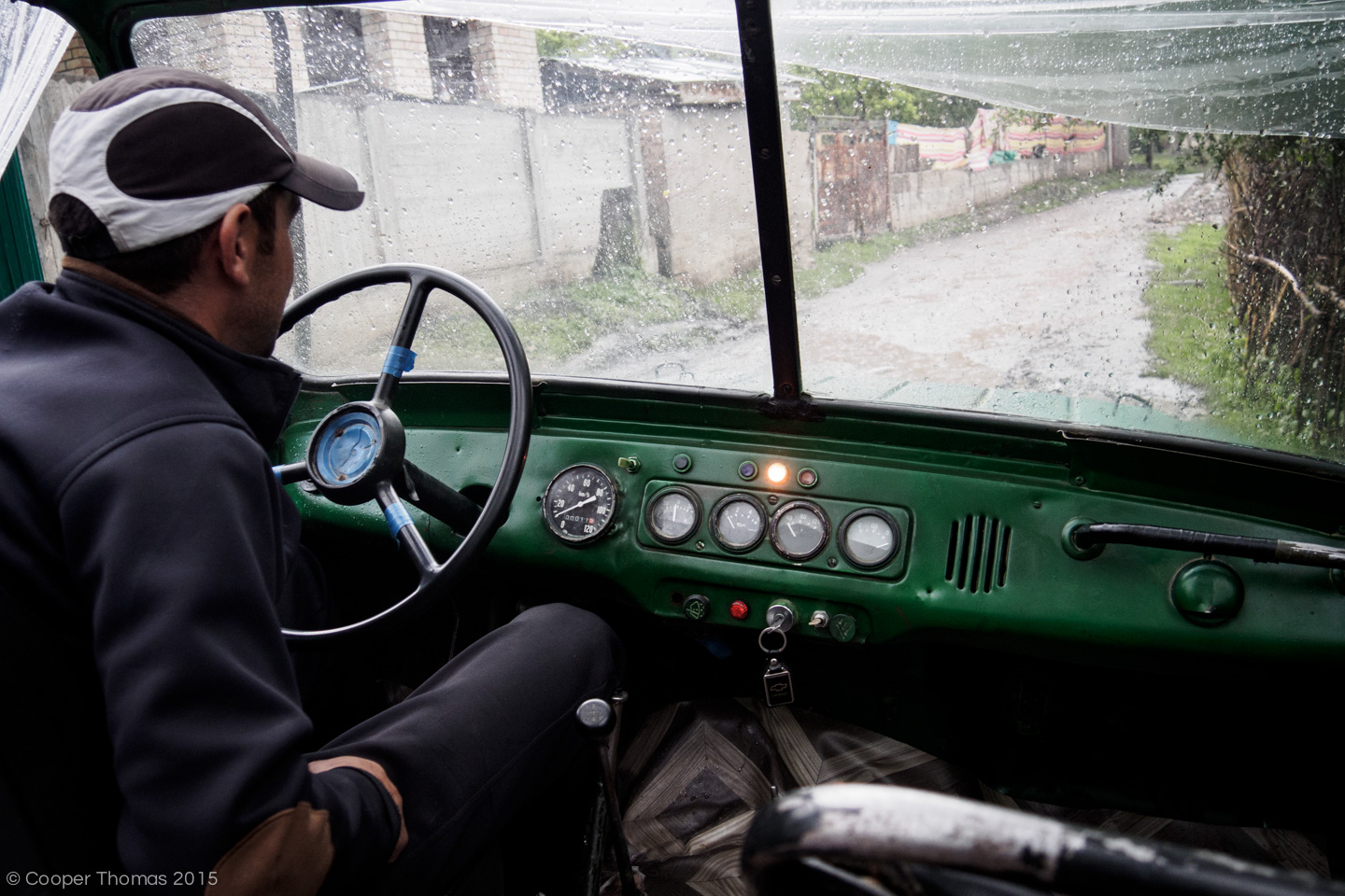 Hassan sits behind the wheel of his trusty UAZ-469